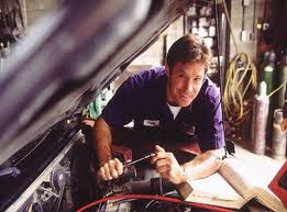 A person is fixing the car