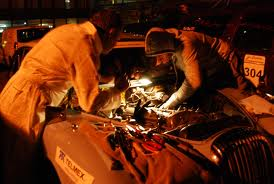 Two people are fixing the car