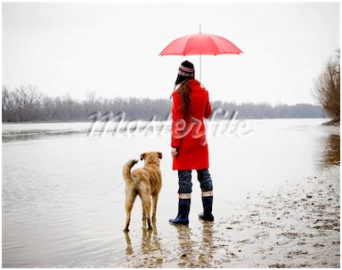 she is taking a walk with her dog