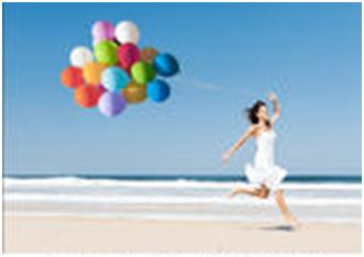 A woman runs on the beach